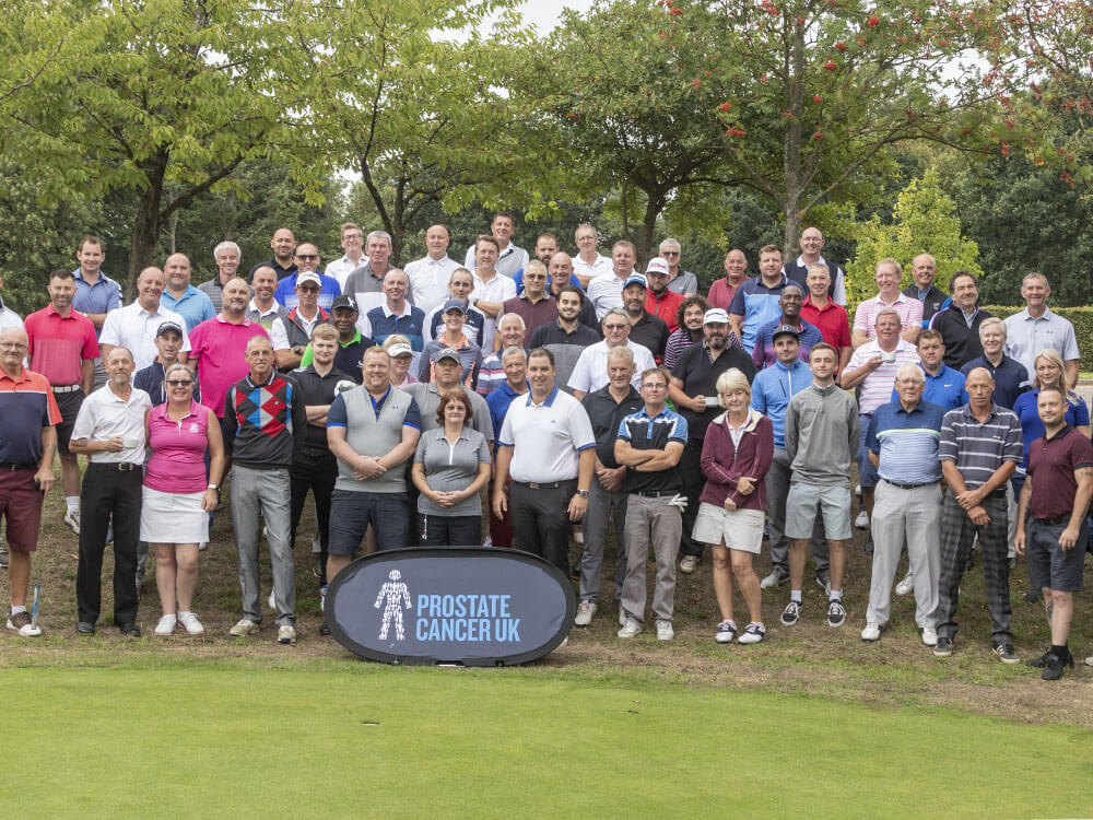 About - Group shot of all many of the members of Stevenage Golf Club on their charity day for prostate cancer UK.